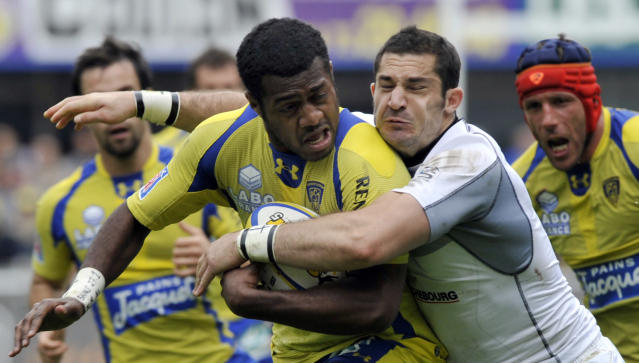 Clermont's fullback Kini Murimurivalu (L) is tackled by Brive's fullback Scott Spedding during the French Top 14 rugby union match ASM Clermont Auvergne vs. Brive on May 12, 2012 at the Marcel Michelin stadium in the French central city of Clermont-Ferrand. AFP PHOTO / THIERRY ZOCCOLANTHIERRY ZOCCOLAN/AFP/GettyImages