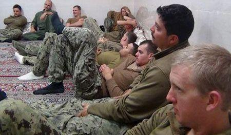 U.S. sailors are seen in an undisclosed location in Iran in this handout picture released on Farsnews website on January 13, 2016. REUTERS/farsnews.com/Handout via Reuters