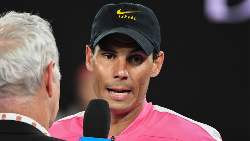 Rafael Nadal pays tribute to Kobe Bryant with a Lakers hat after his fourth round match against Nick Kyrgios of Australia on day eight of the 2020 Australian Open at Melbourne Park on January 27, 2020 in Melbourne, Australia. (Photo by James D. Morgan/Getty Images)