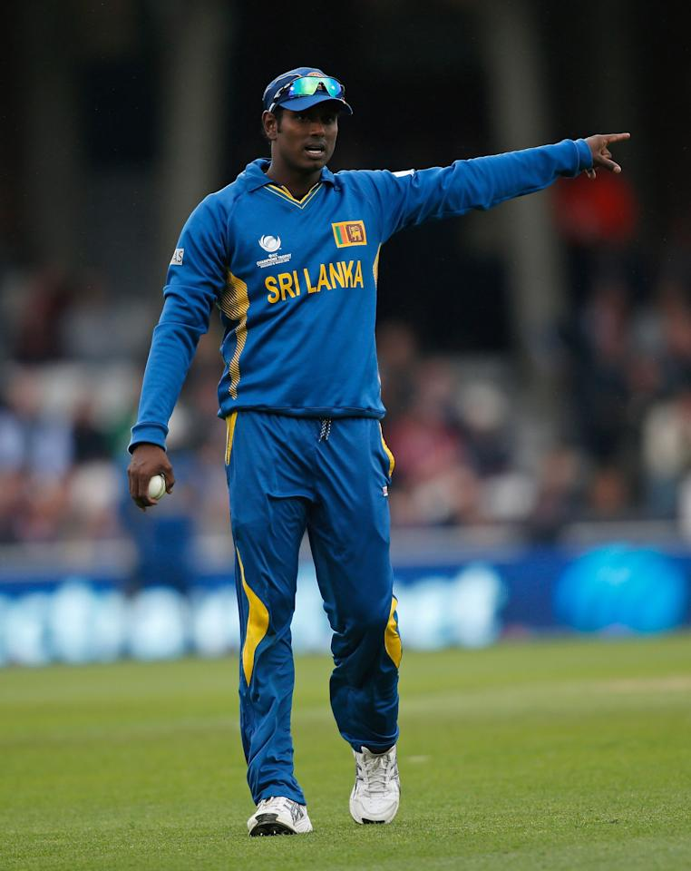 LONDON, ENGLAND - JUNE 13: Sri Lanka captain Angelo Mathews directs his fielders during the ICC Champions Trophy group A match between England and Sri Lanka at The Kia Oval on June 13, 2013 in London, England.  (Photo by Harry Engels-ICC/ICC via Getty Images)