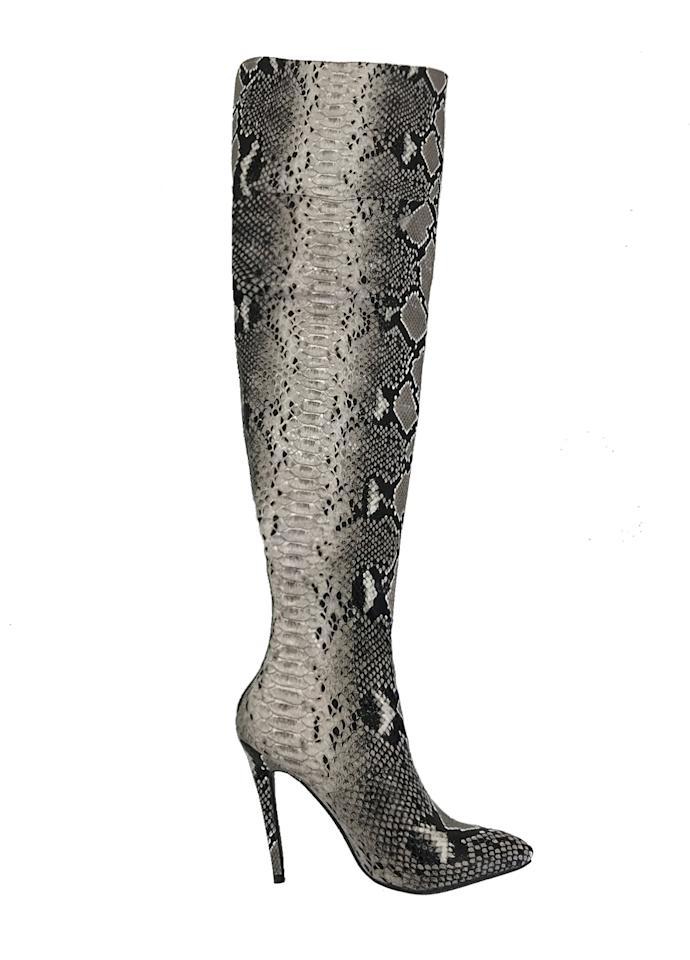 """<p>Buy it <a rel=""""nofollow"""" href=""""https://iamgia.com/collections/shoes/products/viper-thigh-high-boot"""">here</a> for $78.</p>"""