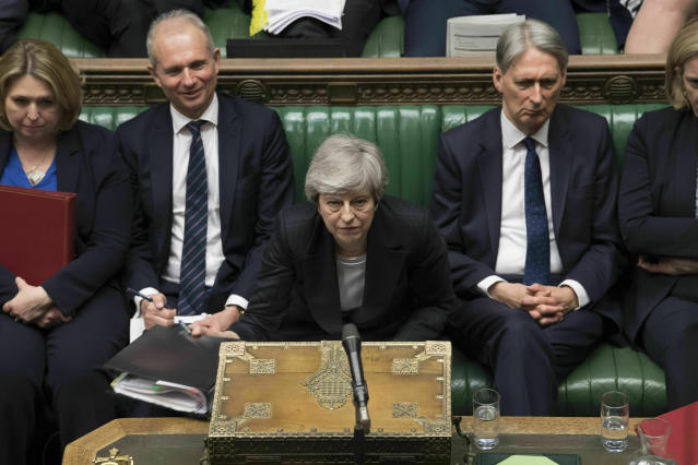 In this image made available by UK Parliament, Britain's Prime Minister Theresa May speaks during Prime Minister's Questions in the House of Commons, London, Wednesday, May 22, 2019. British Prime Minister Theresa May dug in Wednesday against a growing push by both rivals and former allies to remove her from office as her attempts to lead Britain out of the European Union appeared to be headed for a dead end. (Mark Duffy/UK Parliament via AP)
