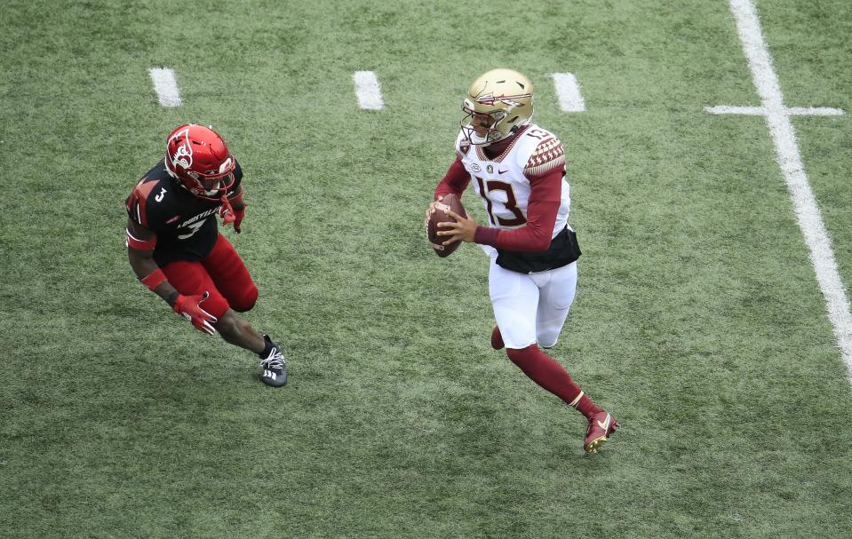 LOUISVILLE, KENTUCKY - OCTOBER 24:   Jordan Travis #13 of the Florida State Seminoles runs with the ball against the Louisville Cardinals at Cardinal Stadium on October 24, 2020 in Louisville, Kentucky. (Photo by Andy Lyons/Getty Images)