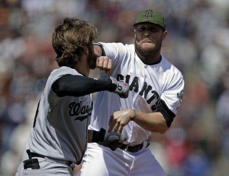 Bryce Harper and Hunter Strickland were punished for their role in Monday's brawl. (AP Photo)