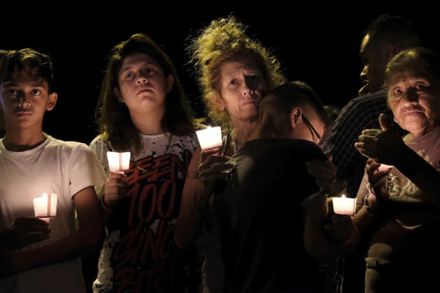From left, Christopher Rodriguez, Esmeralda Rodriguez, Mona Rodriguez, Jayanthony Hernandez, 12, and Juanita Rodriguez participate in a candlelight vigil for the victims of a fatal shooting at the First Baptist Church in Sutherland Springs, Texas, on Sunday, Nov. 5, 2017. (Photo: Laura Skelding/AP)