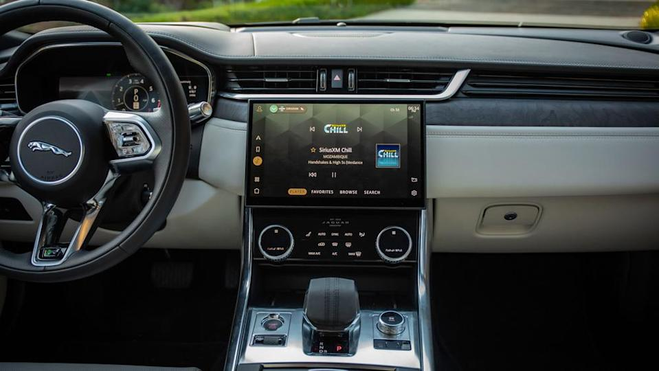 The interior of the XF features a sculpted steering wheel, taken from the I-Pace, and a large touch-sensitive central screen. - Credit: Jaguar Land Rover Automotive PLC.