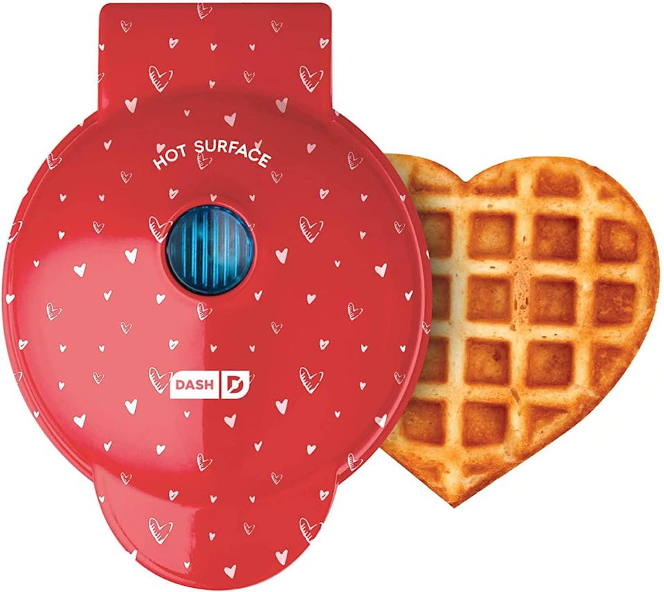 """<h3>Dash Mini Waffle Maker Red Love Heart</h3><br>It's not just men: The way to <em>anyone's</em> heart is through their stomach, so treat yourself (or a lucky loved one) to freshly-made, heart-shaped waffles on V-Day morning.<br><br><strong>Dash</strong> Mini waffle maker, 4 inch, Red Love Heart, $, available at <a href=""""https://amzn.to/3oFpcvO"""" rel=""""nofollow noopener"""" target=""""_blank"""" data-ylk=""""slk:Amazon"""" class=""""link rapid-noclick-resp"""">Amazon</a>"""