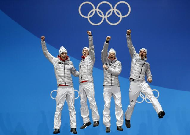 Medals Ceremony - Nordic Combined Events - Pyeongchang 2018 Winter Olympics - Men's Team 4 x 5 km - Medals Plaza - Pyeongchang, South Korea - February 23, 2018 - Gold medalists Vinzenz Geiger, Fabian Riessle, Eric Frenzel and Johannes Rydzek of Germany celebrate on the podium. REUTERS/Kim Hong-Ji