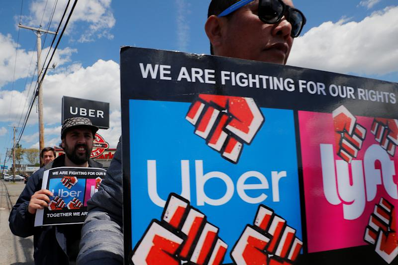 Uber and Lyft drivers protest during a day-long strike outside Uber's office in Saugus, Massachusetts, U.S., May 8, 2019. REUTERS/Brian Snyder