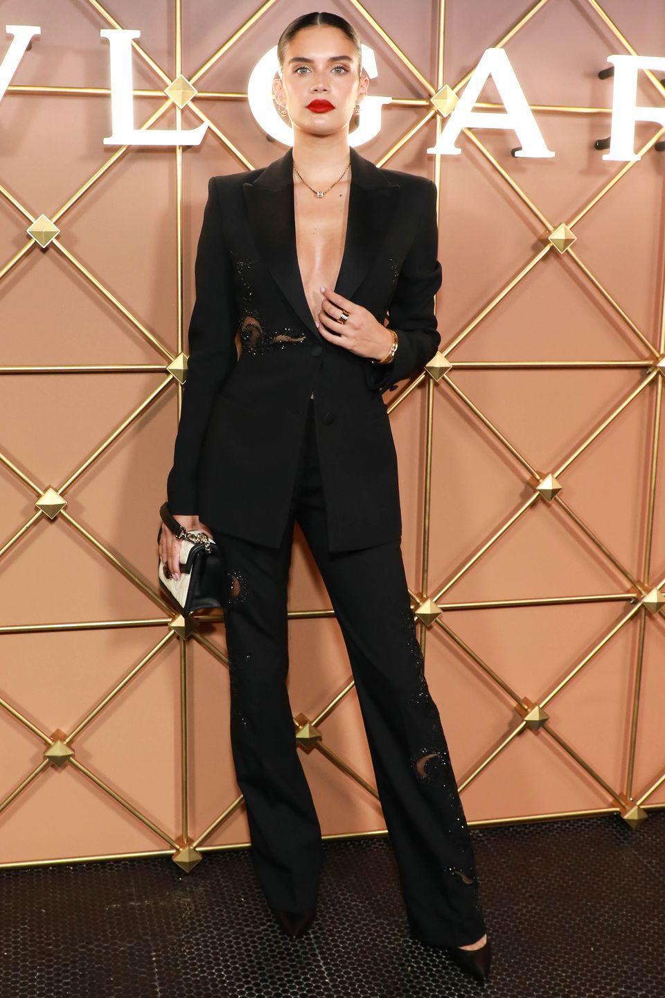 <p><strong>8 September</strong></p><p>Sara Sampaio proved the power of the classic back suit. </p>