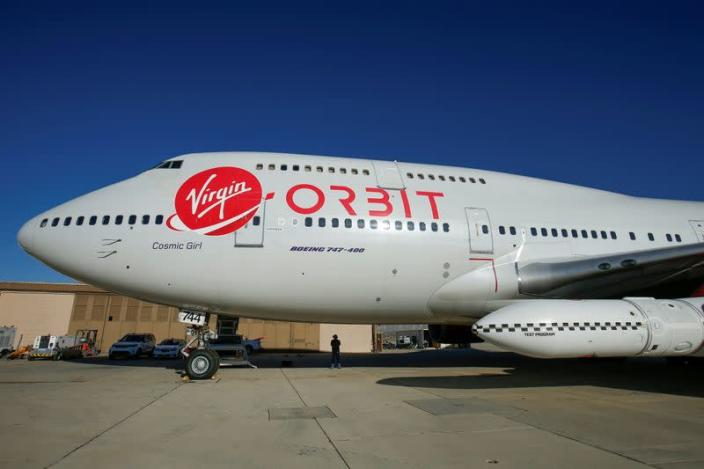FILE PHOTO: Richard Branson's Virgin Orbit, with a rocket underneath the wing of a modified Boeing 747 jetliner, prior to its takeoff on a key drop test of its high-altitude launch system for satellites from Mojave, California
