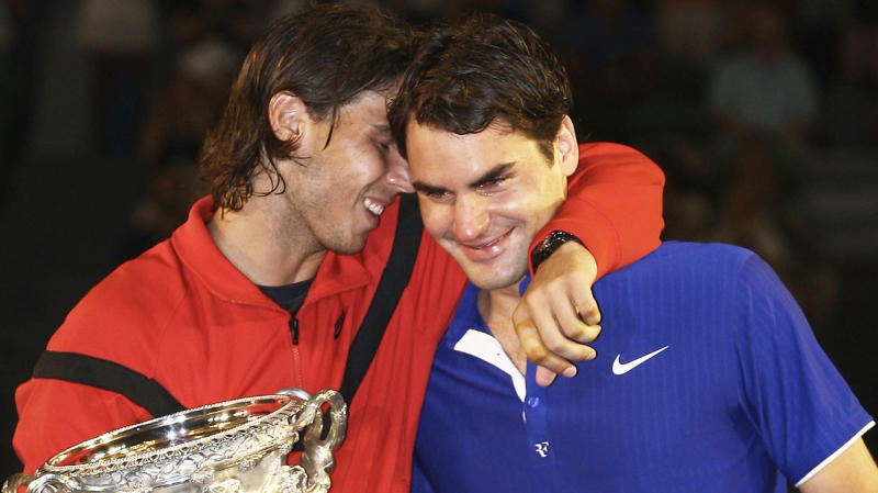 Roger Federer (pictured right) crying after missing out on the Australian Open after losing to Rafael Nadal (pictured left).