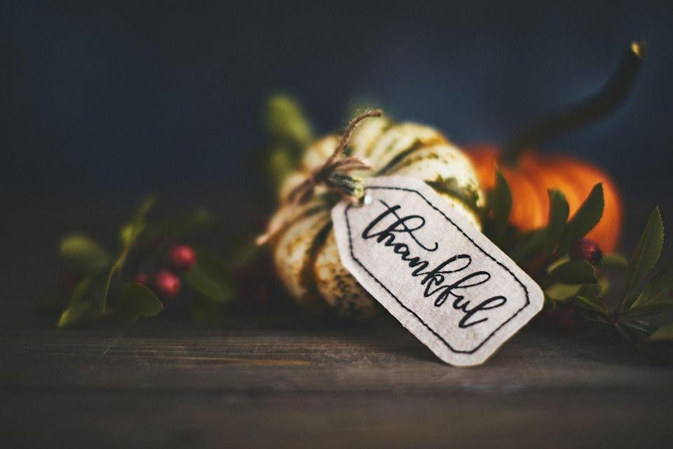 """<p>In all the fun and frenzy, it can be easy to forget the true meaning of Thanksgiving: gratitude. Dole out black sharpies and, before digging in, invite each guest to <a href=""""https://www.oprahmag.com/life/relationships-love/g23742866/celebrity-gratitude-quotes/"""" rel=""""nofollow noopener"""" target=""""_blank"""" data-ylk=""""slk:write what they're thankful for"""" class=""""link rapid-noclick-resp"""">write what they're thankful for</a> on a butcher paper cloth laid over the table. You can archive the sheets to look back on fondly.</p>"""