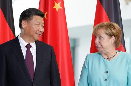 German Chancellor Angela Merkel and Chinese President Xi Jinping attend a contract signing ceremony at the Chancellery in Berlin, Germany, July 5, 2017. REUTERS/Axel Schmidt