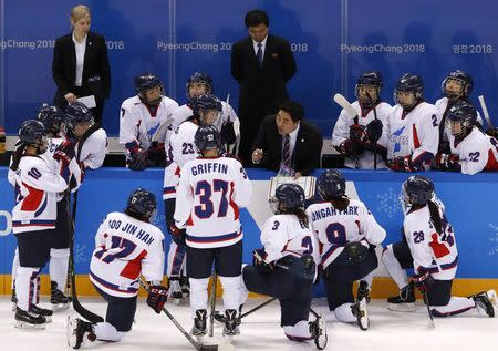 Ice Hockey - Pyeongchang 2018 Winter Olympics - Women's Classification Match - Switzerland v Korea - Kwandong Hockey Centre, Gangneung, South Korea - February 18, 2018 - Coach Sarah Murray and assistant coach Pak choi ho of North Korea (C) watch as their players gather around a team coach. REUTERS/Kim Kyung-Hoon