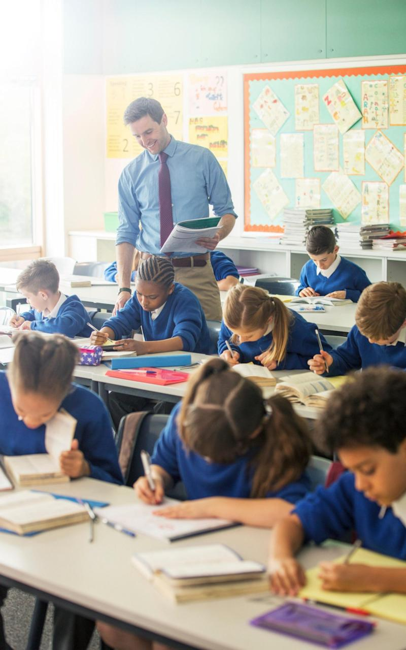 More than four-fifths of school staff (83 per cent) think that their job has had a negative impact on their health and wellbeing in the last 12 months, the survey also found - Credit: Fredrick Kippe / Alamy Stock Photo