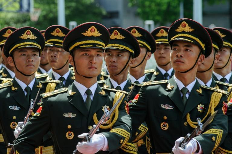 PLA soldiers march during the open day of the Chinese People's Liberation Army (PLA) Navy Base at Stonecutter Island in Hong Kong on July 1, 2016, to mark the 19th anniversary of the Hong Kong handover to China