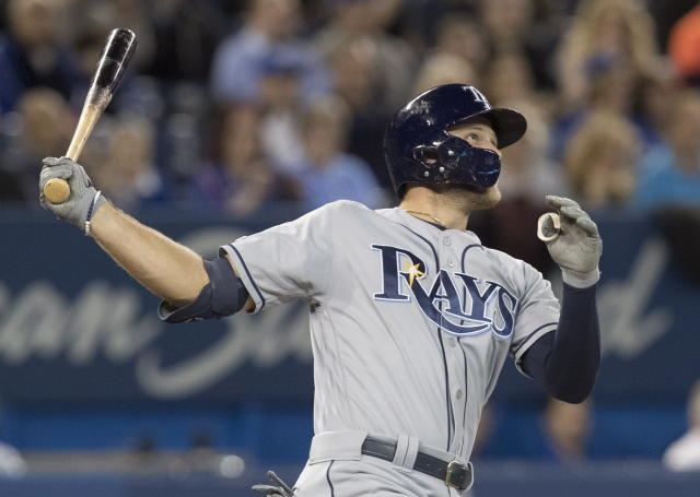 Tampa Bay Rays Austin Meadows watches his home run against the Toronto Blue Jays during the third inning of a baseball game Friday, April 12, 2019, in Toronto. (Fred Thornhill/The Canadian Press via AP)