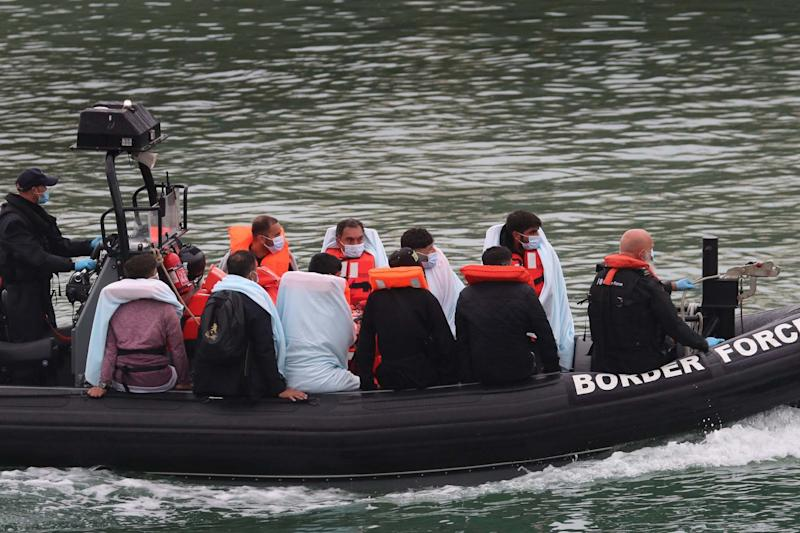 A group of people thought to be migrants are brought into Dover, Kent, onboard a Border Force vessel on August 16: PA