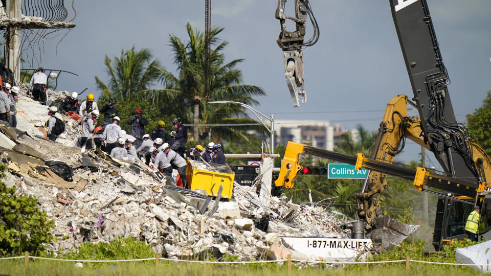 Workers search the rubble at the Champlain Towers South Condo, Monday, June 28, 2021, in Surfside, Fla. Many people were still unaccounted for after Thursday's fatal collapse. (AP Photo/Lynne Sladky)