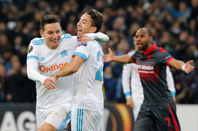 Soccer Football - Europa League Round of 32 First Leg - Olympique de Marseille vs S.C. Braga - Orange Velodrome, Marseille, France - February 15, 2018 Marseille's Florian Thauvin celebrates scoring their third goal with Maxime Lopez REUTERS/Jean-Paul Pelissier