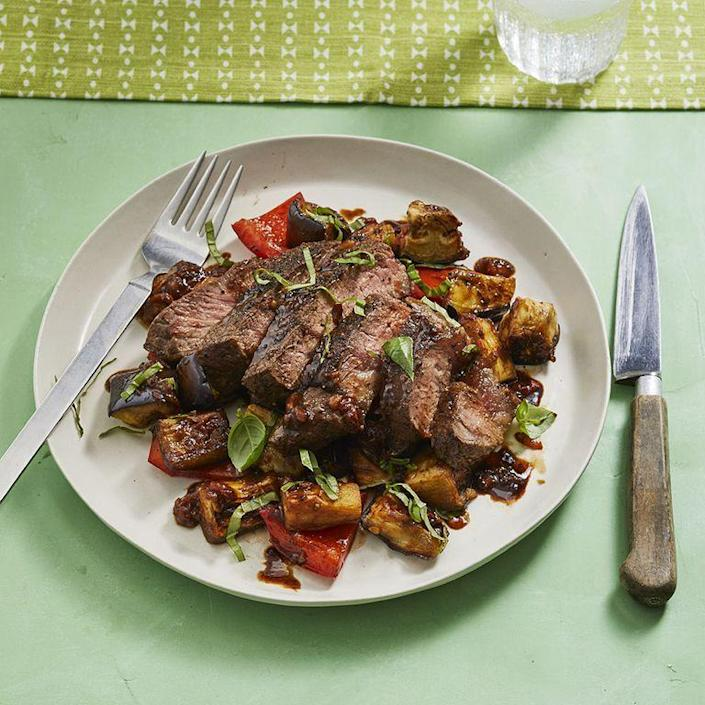 "<p>A steak dinner doesn't always have to be heavy. This light option is served with a vegetable medley of peppers and eggplant. </p><p><em><a href=""https://www.womansday.com/food-recipes/food-drinks/a28354436/balsamic-steak-with-eggplant-and-peppers-recipe/"" rel=""nofollow noopener"" target=""_blank"" data-ylk=""slk:Get the Balsamic Steak with Eggplant and Peppers recipe."" class=""link rapid-noclick-resp"">Get the Balsamic Steak with Eggplant and Peppers recipe. </a></em></p>"