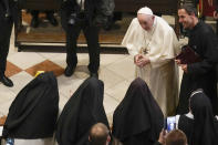 Pope Francis greets nuns as he arrives for a meeting with priests, religious men and women, seminarians and catechists, at the Cathedral of Saint Martin, in Bratislava, Slovakia, Monday, Sept. 13, 2021. Francis is on a four-day visit to Central Europe, in Hungary and Slovakia, in his first big international outing since undergoing intestinal surgery in July. (AP Photo/Gregorio Borgia)