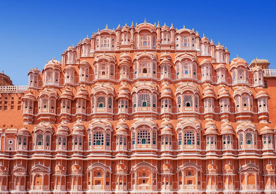 <p>Known as the Palace of the Wind, Jaipur's colorful landmark was constructed in 1799 by Maharaja Sawai Pratap Singh. The pink-painted, honeycomb-like palace features 953 windows, which allowed the ladies of the royal court to observe the bustling city without being seen. </p><p>The palace's delicate latticework and five-storied structure resembles the crown of the Hindu god Krishna, who Singh devoted the palace to. Hawa Mahal's distinctive blush tone comes from sandstone native to the region. Today, visitors can stroll the narrow halls of the pink palace and explore a small museum with miniature paintings and ceremonial relics of its royal past. <br></p>