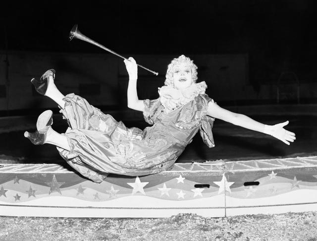 """<p>Lulu Albertino, who claims to be the only woman clown in an American circus, makes her debut with the Ringling Brothers and Barnum & Bailey Circus at Madison Square Garden in New York, April 5, 1939. Lulu says """"clowning is an up and down existence,"""" and it's the """"downs"""" such as this which get the biggest laughs. (AP Photo/Tom Sande) </p>"""