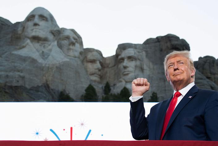 US President Donald Trump pumps his fist as he arrives for the Independence Day events at Mount Rushmore National Memorial in Keystone, South Dakota, July 3, 2020.