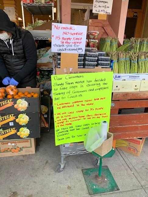 """Signs explain the """"no mask, no service"""" policy of Vancouver's Sandy Farm Market grocery store in the neighbourhood of Kerrisdale. Photo: Caroline Wang"""