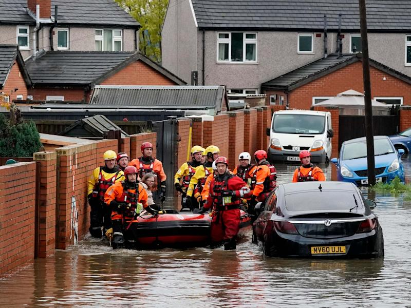 A resident is rescued by boat in Doncaster, one of the areas that had the biggest deluges: Getty