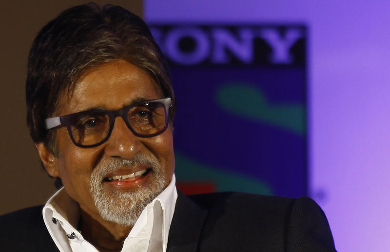 "Bollywood actor Amitabh Bachchan smiles during a press conference in Mumbai, India, Wednesday, June 5, 2013. Bachchan, host of the popular quiz show ""Kaun Banega Crorepati"", India's version of ""Who Wants To Be A Millionaire"", is now said to produce a fiction show for the same channel. (AP Photo/Rafiq Maqbool)"