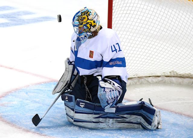 SOCHI, RUSSIA - FEBRUARY 08: Noora Raty #41 of Finland makes a save against United States during the Women's Ice Hockey Preliminary Round Group A Game on day 1 of the Sochi 2014 Winter Olympics at Shayba Arena on February 8, 2014 in Sochi, Russia. (Photo by Martin Rose/Getty Images)