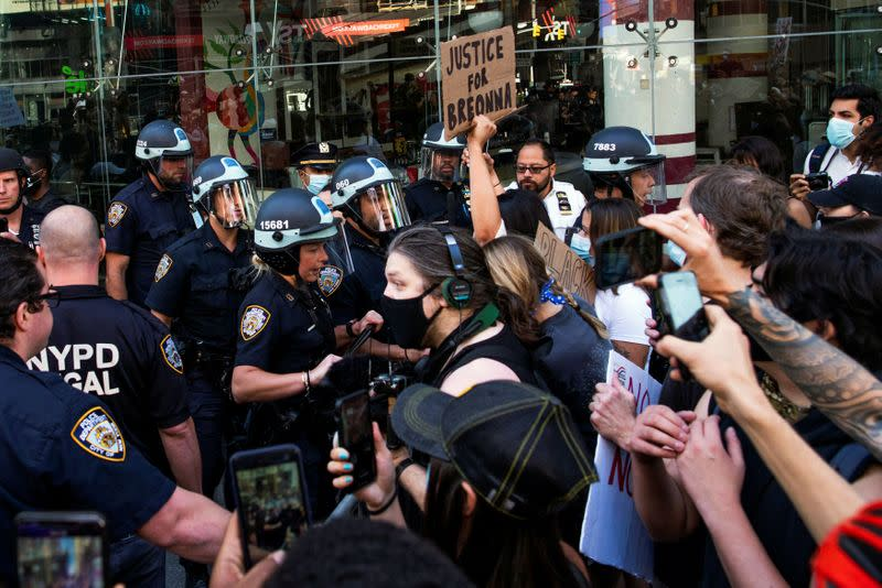 Demonstrators scuffle with NYPD police officers as they try to march trough Times Square during a protest against racial inequality in the aftermath of the death in Minneapolis police custody of George Floyd, in New York City, New York