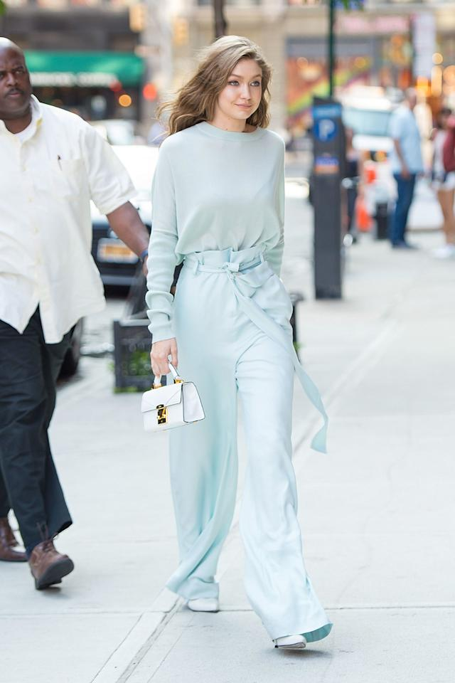 """<p><a rel=""""nofollow"""" href=""""http://www.seventeen.com/fashion/trends/news/a45631/paper-bag-pants-pinterest/"""">Pinterest's hottest trend</a> just got the Gigi Hadid treatment! She paired powder blue paper bag pants with a matching slouchy sweater and yet another mini bag.</p>"""
