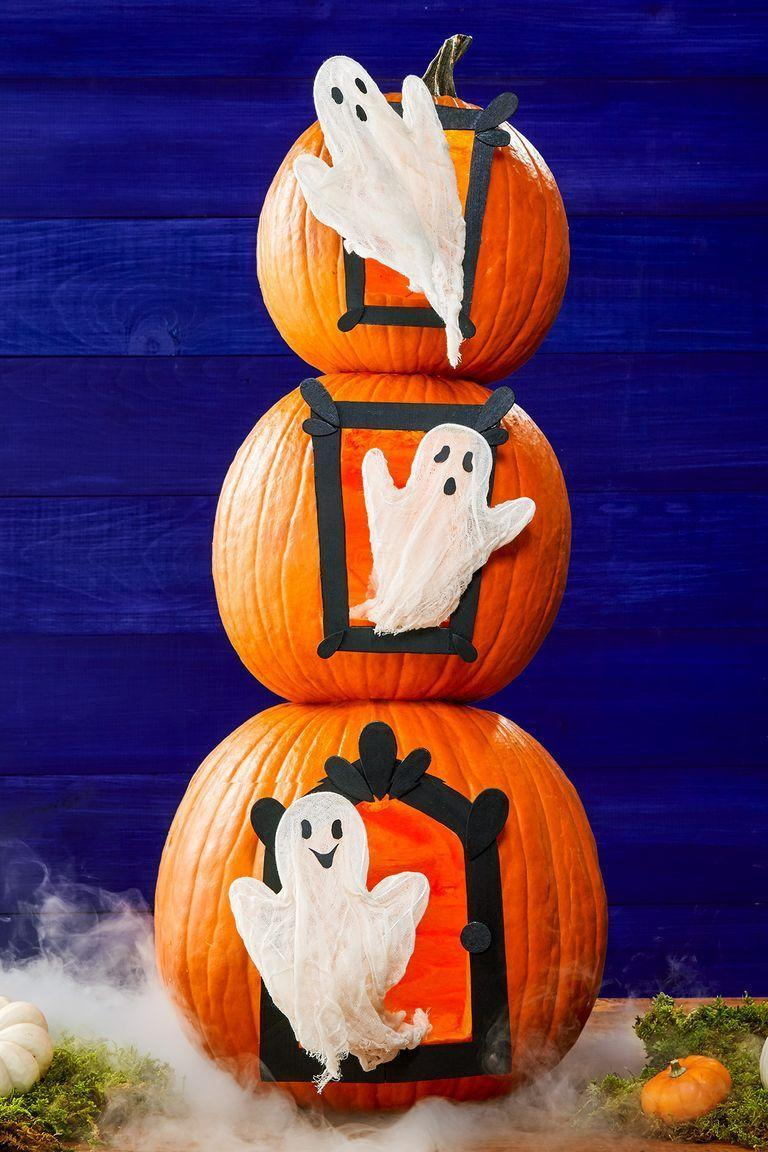 """<p>Caspar and gang will give trick-or-treaters a friendly fright with this stacked pumpkin display. Just make sure you draw smiles on the ghosts, so no one gets spooked. </p><p><em><a href=""""https://www.womansday.com/home/crafts-projects/g950/funny-pumpkin-carving-ideas"""" rel=""""nofollow noopener"""" target=""""_blank"""" data-ylk=""""slk:Get the tutorial at Woman's Day »"""" class=""""link rapid-noclick-resp"""">Get the tutorial at Woman's Day »</a></em></p>"""