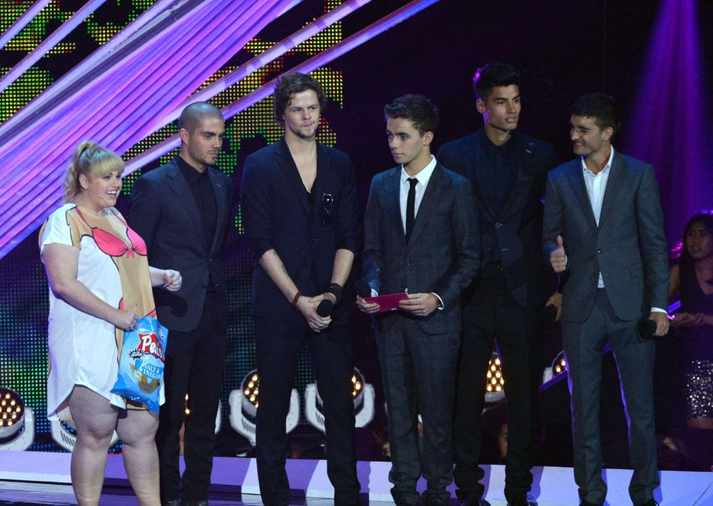 LOS ANGELES, CA - SEPTEMBER 06:   (L-R) Actress Rebel Wilson and singers Max George, Jay McGuiness, Nathan Sykes, Siva Kaneswaran and Tom Parker of The Wanted speak onstage during the 2012 MTV Video Music Awards at Staples Center on September 6, 2012 in Los Angeles, California.  (Photo by Lester Cohen/WireImage)