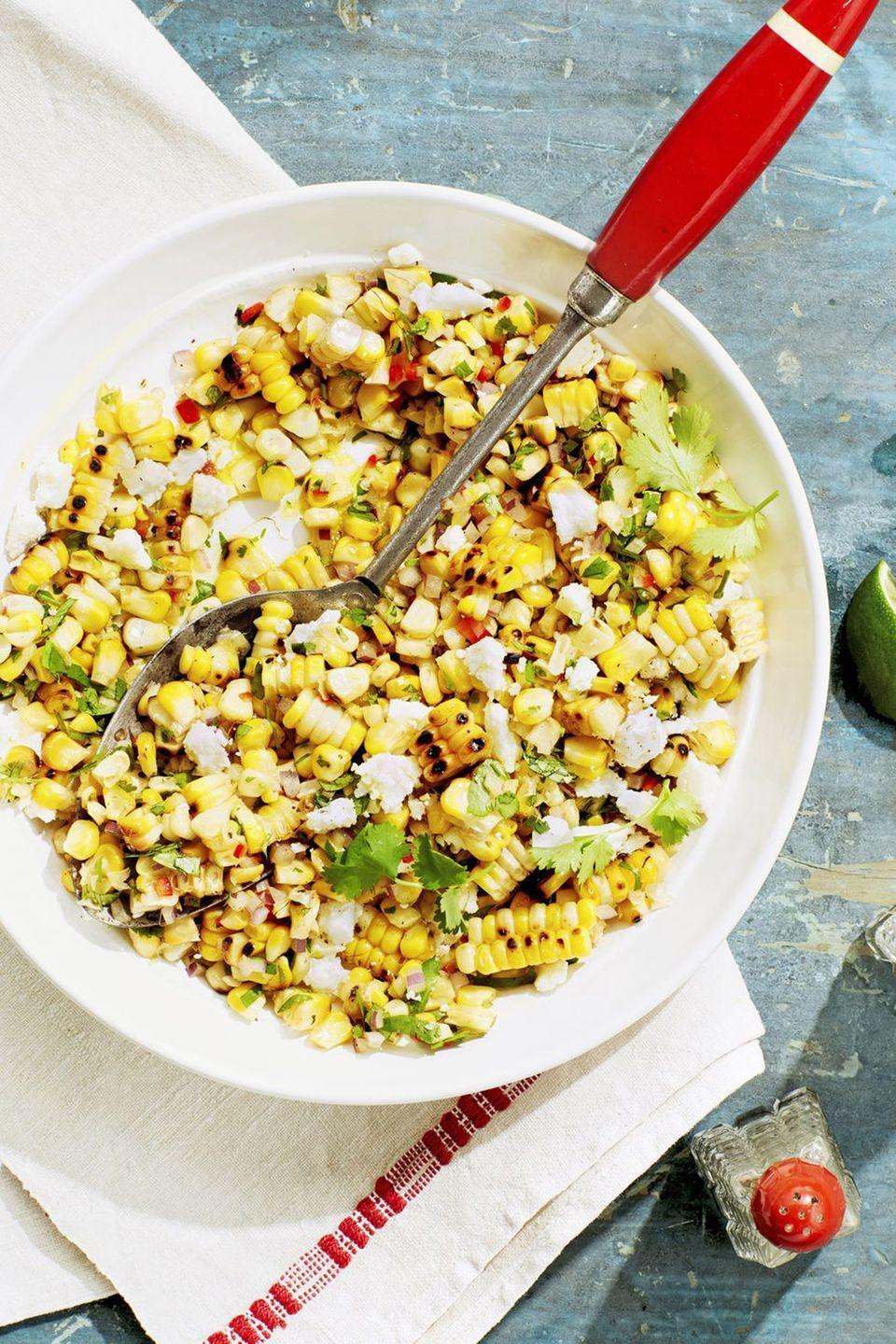 """<p>Finish off this grilled corn with cool queso fresco. It makes the mix absolutely addicting.<br></p><p><strong><a href=""""https://www.countryliving.com/food-drinks/a21347904/charred-corn-salad-recipe/"""" rel=""""nofollow noopener"""" target=""""_blank"""" data-ylk=""""slk:Get the recipe"""" class=""""link rapid-noclick-resp"""">Get the recipe</a></strong><strong>.</strong> </p>"""