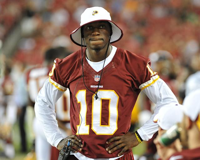 TAMPA, FL - AUGUST 29: Quarterback Robert Griffin III of the Washington Redskins watches play against the Tampa Bay Buccaneers August 29, 2013 at Raymond James Stadium in Tampa, Florida. (Photo by Al Messerschmidt/Getty Images)