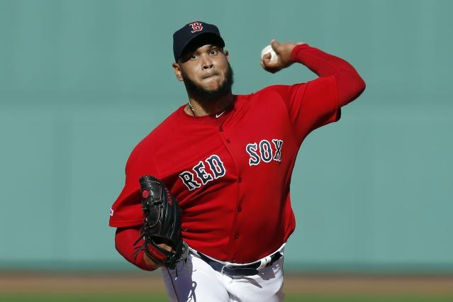 FILE - In this Sunday, Sept. 29, 2019 file photo, Boston Red Sox's Eduardo Rodriguez pitches during the first inning of a baseball game against the Baltimore Orioles in Boston. Boston pitcher Eduardo Rodrguez argued his case Wednesday, Feb. 12, 2020 asking for a raise to $8,975,000 rather than the $8.3 million offer of the Red Sox. A right-hander who turns 27 in April, Rodrguez was a career-best 19-6 with a 3.81 ERA in 34 starts last season, when he made $4,325,000. He is eligible for free agency after the 2021 season.(AP Photo/Michael Dwyer, File)