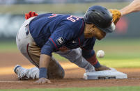 Minnesota Twins' Jorge Polanco steals third base during the third inning of the team's baseball game against the Seattle Mariners, Wednesday, June 16, 2021, in Seattle. (AP Photo/Stephen Brashear)