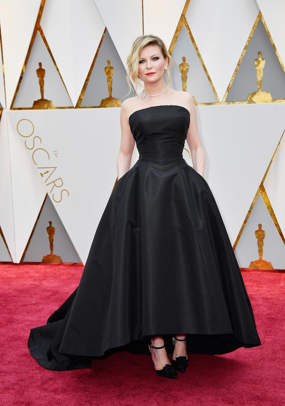 <p>Kirsten Dunst's high-low hem showed off some pretty amazing shoes underneath a voluminous skirt.<em> (Photo: Getty Images)</em> </p>