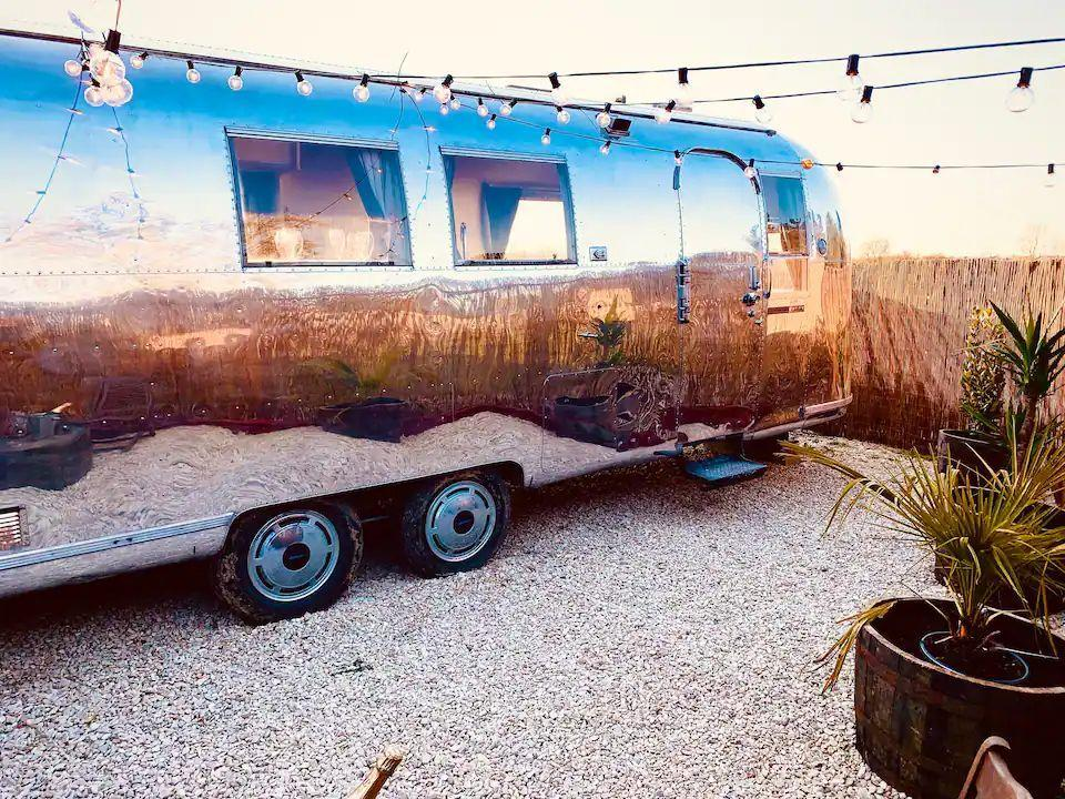 """<p>A cool place to stay in Oxfordshire, this 1960s Airstream allows you to experience the over-engineered version of American camping. Renovated to a high standard with a curved double bed, a lazy sofa area and a stylish wet room with a hot shower, this unique stay has all the modern essentials too.</p><p>There's the TV with Netflix, a Bluetooth speaker, oven, toaster and BBQ. Plus, it sits in the quiet village of Banbury near the local pub and is close to Blenheim Palace.</p><p><strong>Sleeps:</strong> 2</p><p><strong>Available from:</strong> <a href=""""https://airbnb.pvxt.net/yRrD3b"""" rel=""""nofollow noopener"""" target=""""_blank"""" data-ylk=""""slk:Airbnb"""" class=""""link rapid-noclick-resp"""">Airbnb</a></p><p><strong>Price: </strong>One night from £150</p><p><a class=""""link rapid-noclick-resp"""" href=""""https://airbnb.pvxt.net/yRrD3b"""" rel=""""nofollow noopener"""" target=""""_blank"""" data-ylk=""""slk:CHECK AVAILABILITY"""">CHECK AVAILABILITY</a></p>"""
