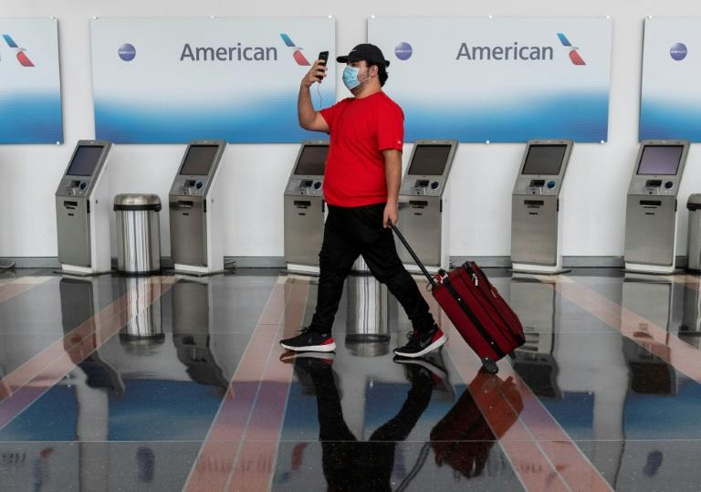 American Airlines has taken steps to cut costs, but it was not enough to prevent a downgrade of its credit rating (AFP Photo/ANDREW CABALLERO-REYNOLDS)