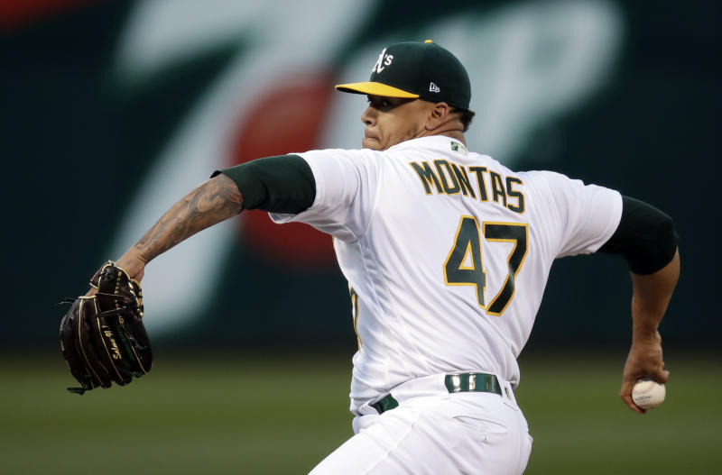 Oakland Athletics pitcher Frankie Montas works against the Houston Astros during the first inning of a baseball game Wednesday, April 17, 2019, in Oakland, Calif. (AP Photo/Ben Margot)