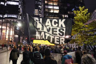 FILE - In this Nov. 4, 2020, file photo, protesters representing Black Lives Matter and Protect the Results march in Seattle. A financial snapshot shared exclusively with The Associated Press shows the Black Lives Matter Global Network Foundation took in just over $90 million last year. (AP Photo/Ted S. Warren, File)