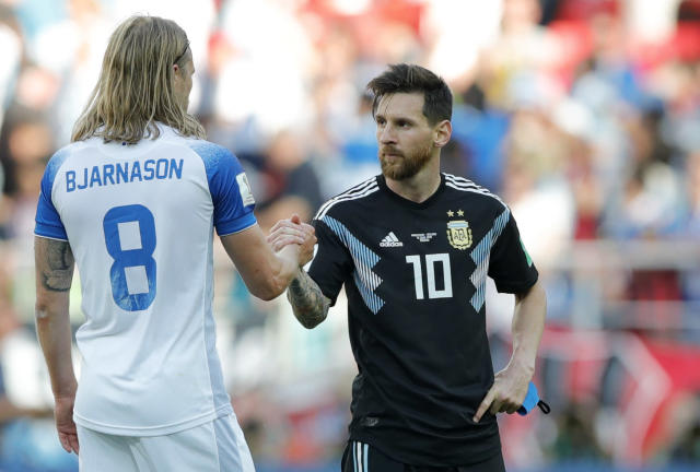 Argentina's Lionel Messi, right, shake hands with Iceland's Birkir Bjarnason at the end of the group D match between Argentina and Iceland at the 2018 soccer World Cup in the Spartak Stadium in Moscow, Russia, Saturday, June 16, 2018. (AP Photo/Ricardo Mazalan)