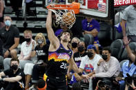 Phoenix Suns forward Dario Saric (20) dunks against the Denver Nuggets during the first half of Game 2 of an NBA basketball second-round playoff series, Wednesday, June 9, 2021, in Phoenix. (AP Photo/Matt York)