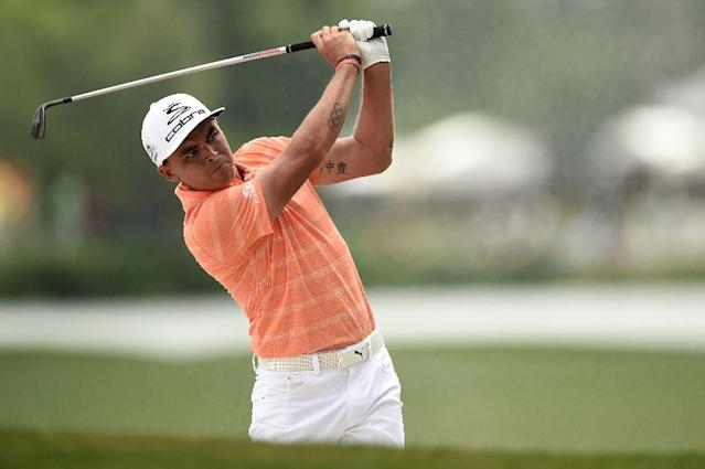 Rickie Fowler plays his second shot on the 18th hole during the final round of the Shell Houston Open at the Golf Club of Houston on April 2, 2017 in Humble, Texas (AFP Photo/Stacy Revere)
